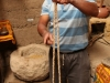 Loui's uncle showing us an Inca sling shot for hunting